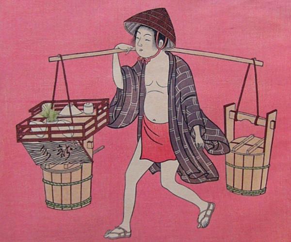 天秤棒を担ぐ近江商人